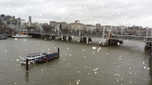 Image: Rain drops on the window. View towards Hungerford Bridge.