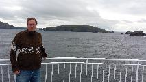 Image: Me, with Unst in the background. We had some more wind on the return trip.