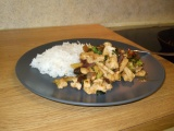 Image: Chicken wok: Broccoli, red onion, leek, and chili prepared in a wok with chicken and a soy, garlic and ginger sauce. Served with cooked jasmine rice.