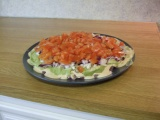 Image: 7-layer dip: 5th layer: chopped tomatoes.
